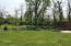 Enjoy the beautiful expansive yard and tasteful landscaping. Multiple tree lines offer year round privacy