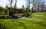 Notice the greenery lining the west side of the property for added privacy!