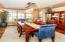 Maple hardwood floors, transom windows, and ceiling details.