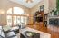 The 2 story great room with vaulted ceiling, has maple hardwood floors, a gas fireplace with stone surround, and built-ins.