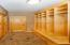 The mudroom off the garage features built-in lockers and closet.