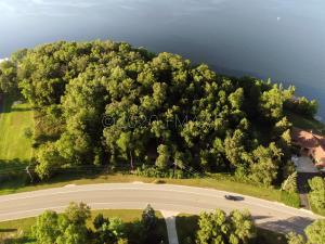 550 feet of lake shore property and 5.65 acres!