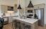 Quartz, tile bs, ss appl, islnd, pntry, wine cubbies, custom cabinets