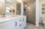 Quartz tops, double sinks, glass enclosed tile shower, linen closet, semi-private stool space