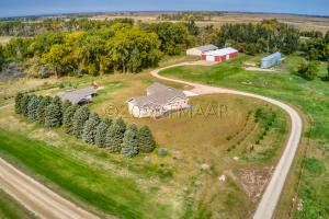 10.4 acre (A) farmstead with outbuildings and a modern 5 bedroom Ranch home!