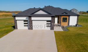 Front - Welcome Home! South facing on a huge 1.2 acre lot!