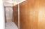 Hallway view to remodeled bathroom. . Lots of Closet space