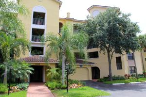 Located in Ocean Trace, a gated community. Top floor, corner unit.