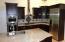 Beautiful custom kitchen with Miele appliances.