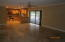 Large family room that opens to the kitchen and large screened patio.