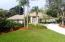 Beautifully landscaped front yard with wide driveway to accommodate many cars.