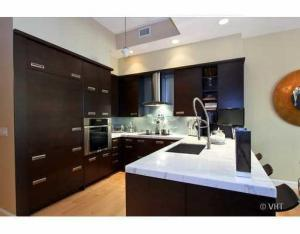 Beautifully upgraded kitchen with marble counters and large breakfast bar, upgraded cabinets, built in Sub Zero refrigerator, Miele Range and more!