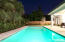 Large 26 x 13 pool with four sets of french doors that give access to a lushly landscaped and private backyard.