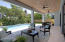 Large outdoor covered area (30 X 12) with four sets of French Doors to your outdoor paradise just steps from the sand in Singer Island. Impact Glass throughout. Gas quick connect for outdoor kitchen or grill.