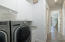 Brand new Samsung Gas dryer and washer with pedestals, matching cabinets and laundry sink.