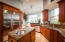 Gourmet Kitchen with Granite Countertops and Stainless Steel Appliances