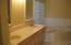 MASTER BATH HAS DOUBLE SINKS AND TUB.