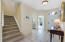 Bright and light Foyer with easy care tile floors.