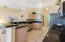 Kitchen boasts Quartz counter tops and Stainless Steel Appliance Suite with a GAS Range.