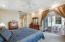 Highly sought after first floor Master Bedroom with His and Her Closets, En-Suite Bathroom, and direct Patio access. Master Bathroom has His and Her vanities and separate tub and shower.