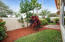 Backyard with extended paved patio and easy care yard.