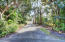 NorthSide Driveway to leads to Lanai & back entrance to home.