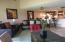 view of family room, bar, kitchen
