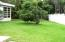 Large Corner Lot gives you space on all sides of the house! Right side yard with fruit / mango trees!