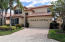 Two-Story Impressive Front of Home with small private driveway entrance