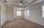 Large master bedroom upstairs with lake view. Extra room sitting or small entertainment area.