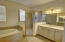 Huge master bath with soaking tub, separate shower, duel vanities, and separate water closet.