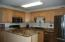 updated kitchen with granite counters and ss appliances