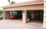 Three-car garage, view with doors open to show clean, texture painted floor.