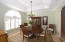 Formal dining room with tray ceiling and custom plantation shutter.