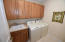 Large laundry room conveniently in center of living area.