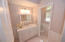 Charming white and delicate soft touch to the guest bathroom. Seamless glass, a window of more natural light.