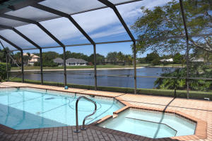 As you walk out of multiple french doors onto large enclosed pool and spa overlooking pristine lake. Location, Location, Location! This home offers you more that you can imagine.