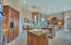 Large kitchen with island, granite counters and breakfast bar