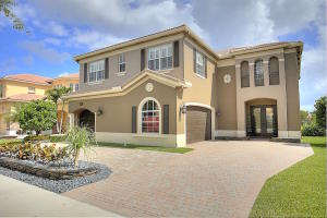 Welcome home to 8721 Cobblestone Point Circle. Stunning curb appeal is just the beginning.