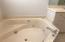 His and her sinks, dressing area, large shower, linen closet make this master bath perfect!