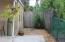 Sidewalk to fenced in back yard