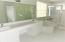Double Sinks, Roman Tub and Walk In Shower.