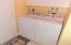 Laundry Tub, Overhead Cabinets.