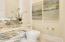 1/2 Bath @ Entry w/Onyx Vanity - Backlit Mirror