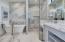 Separate Water Closet - Dual Sinks. Backlit Mirrors