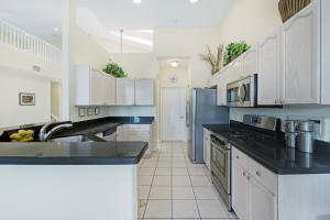 Kitchen with Newer Quartz counter tops, Newer Stainless Steel Appliances including a Gas Range, and pantry!