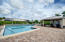 Private paved pool with poolhouse featuring wet-bar, refrigerator, microwave and restrooms