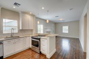 Completely renovated from top to bottom. New Kitchen cabinets, counters, appliances, recessed lighting & beautifully refinished floors. Impact Glass throughout and new security system.