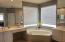 HIS AND HER SINKS, BEAUTIFUL ROMAN TUB AND SEPARATE SHOWER