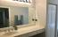 VERY LARGE GUEST BATHROOM ALSO HAS A NICE DRESSING TABLE AREA, A LINIEN CLOSET AND LOVELY BATH AND SHOWER!